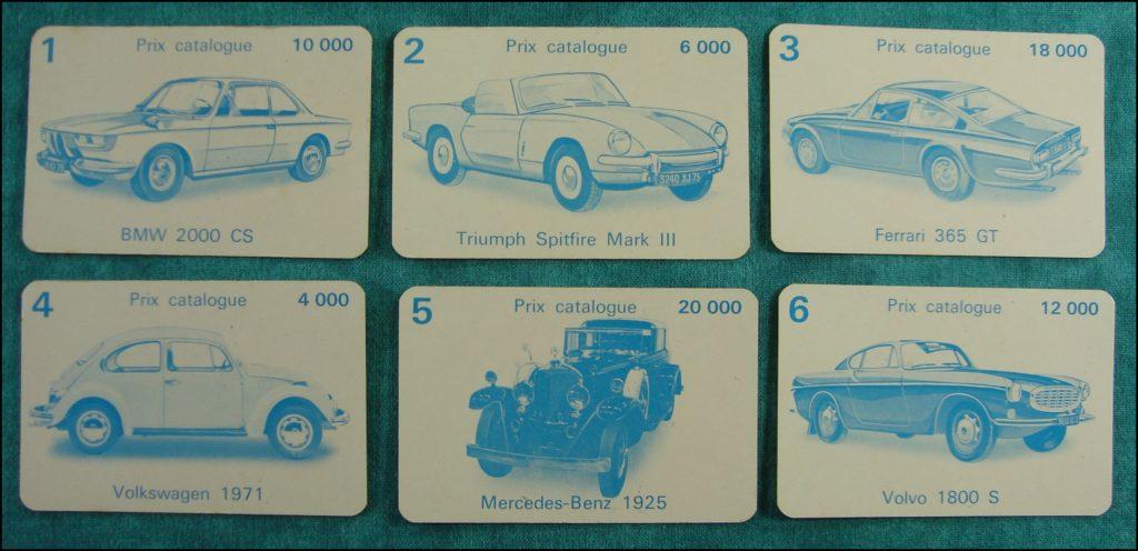 Brettspiel ; Board game ; Jeu de société ; 1973 ; La belle occase ; Miro ; BMW 2000 CS ; Triumph Spitfire Mark III ; Ferrari 365 GT ; Volkswagen ; Mercedes-Benz ; Volvo 1800 S ; Renault 16 ; Alfa Romeo 1750 GT Veloce ; Mercedes 280 SL ; Jaguar Type E ; Reo 1905 ; Cadillac ; Citroën 2 CV ; DS ; Chevrolet Corvette ; Renault 4L ; Bugatti 1938 ; Peugeot 304 ; Fiat Dino Coupé ; Ford A 1931 ; Harley side car ; Simca 1301 Spécial ; Porsche 911 L Targa